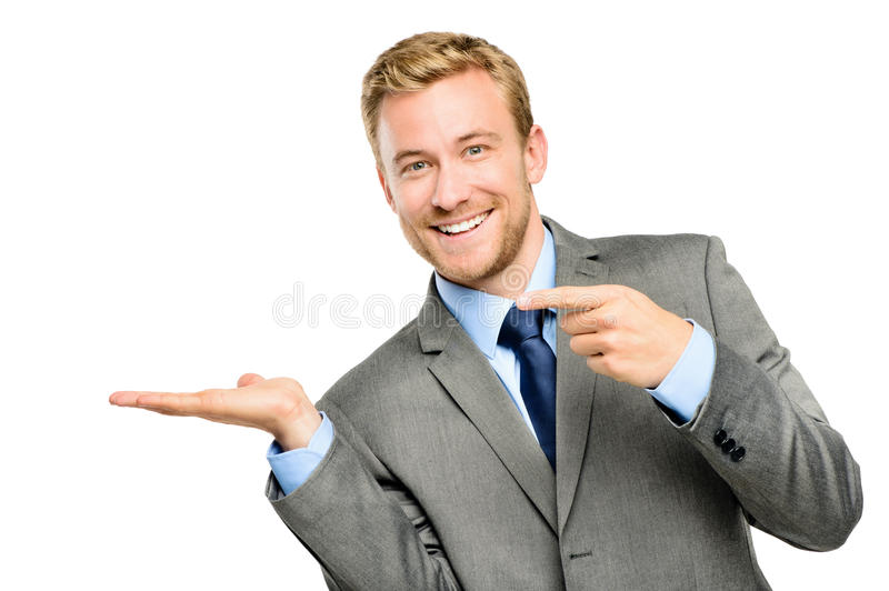 Happy young businessman showing empty copyspace on white background stock photos
