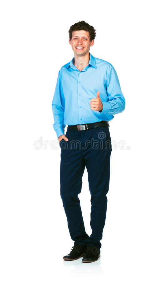 Happy young businessman standing with thumb up on white. Background royalty free stock images