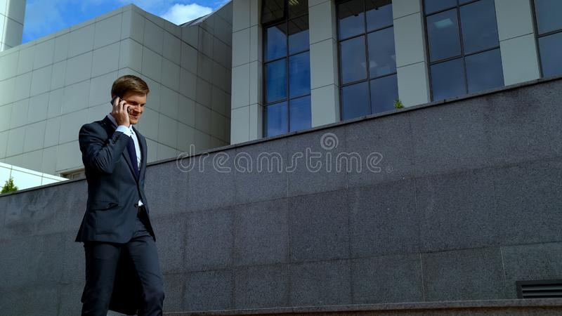 Happy young businessman talking on phone, receiving good news, successful deal. Stock photo royalty free stock photos