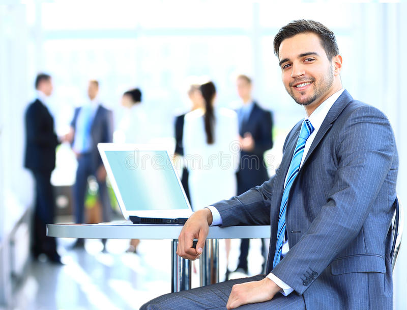 Happy young businessman using laptop royalty free stock image