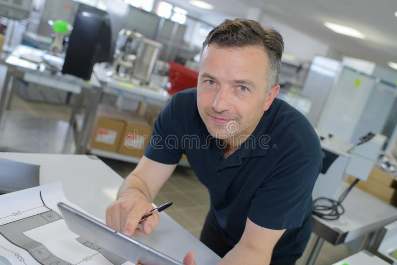 Happy young businessman using pc digital tablet in office royalty free stock images
