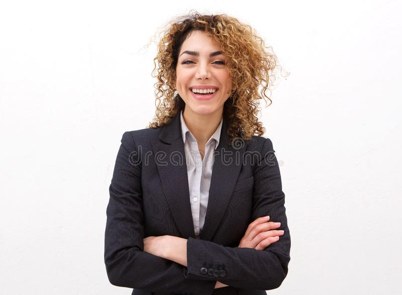 Happy young businesswoman against white background royalty free stock image