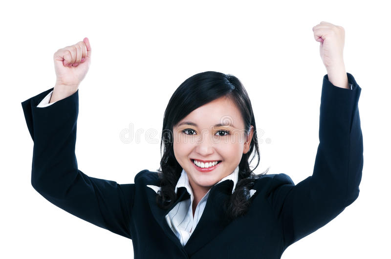Happy young businesswoman with her arms raised royalty free stock photography