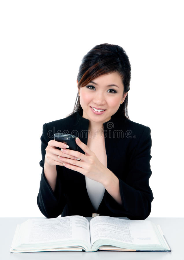 Happy young businesswoman holding mobile phone royalty free stock photo