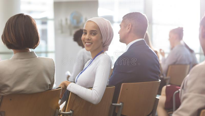 happy young businesswoman looking at camera during seminar royalty free stock photos
