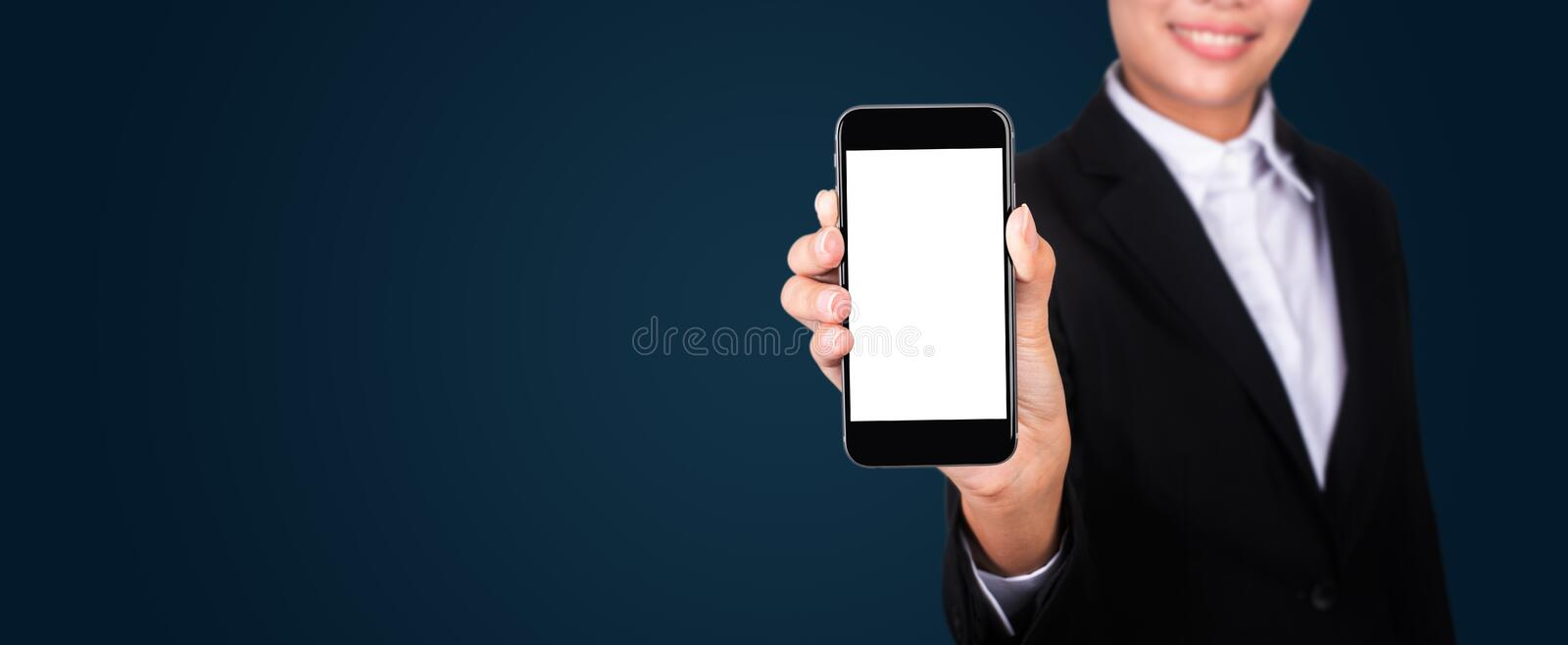 Happy young businesswoman showing blank smartphone screen. stock images