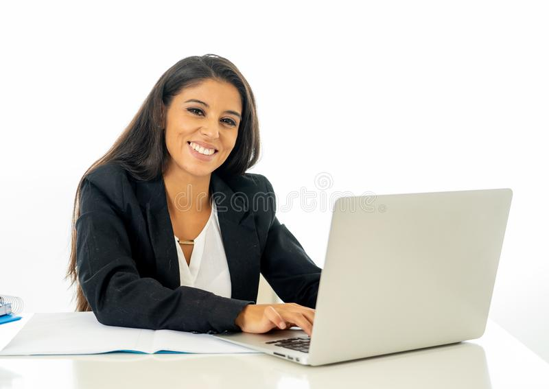 Happy young businesswoman working on her computer on her desk in satisfied at work and successful woman isolated on white stock photo