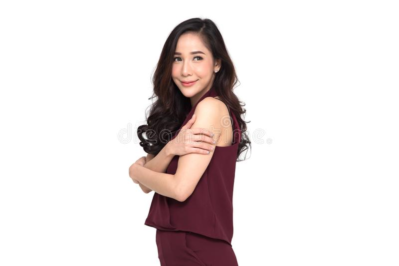 Happy young casual asian woman hugging herself isolated on white background. stock photos