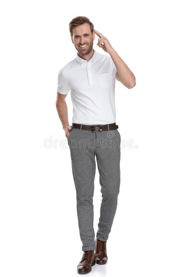 Happy young casual man giving a military salute stock images