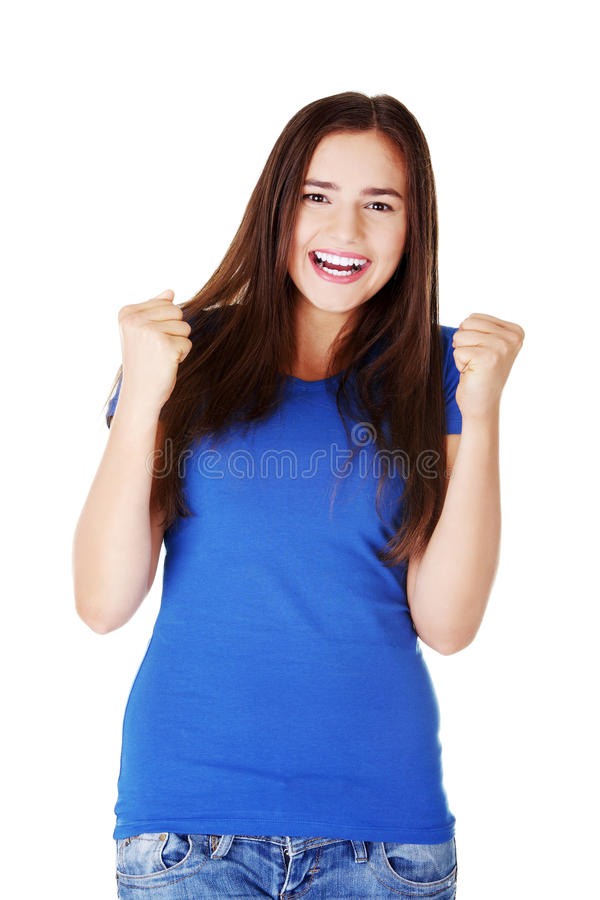 Happy young casual woman with closed fists. royalty free stock photography
