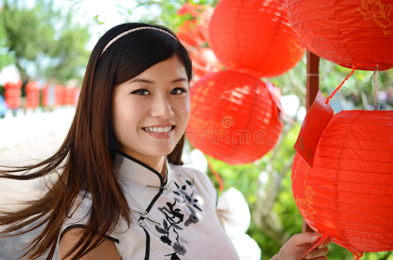 Happy young chinese woman stock images