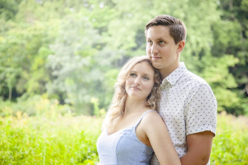 Happy young close couple portrait outdoors royalty free stock image