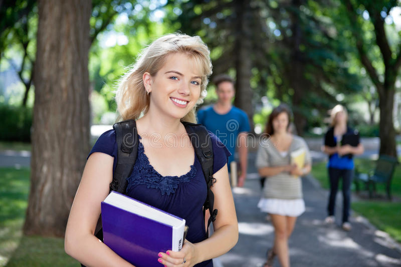 Happy young college girl royalty free stock image