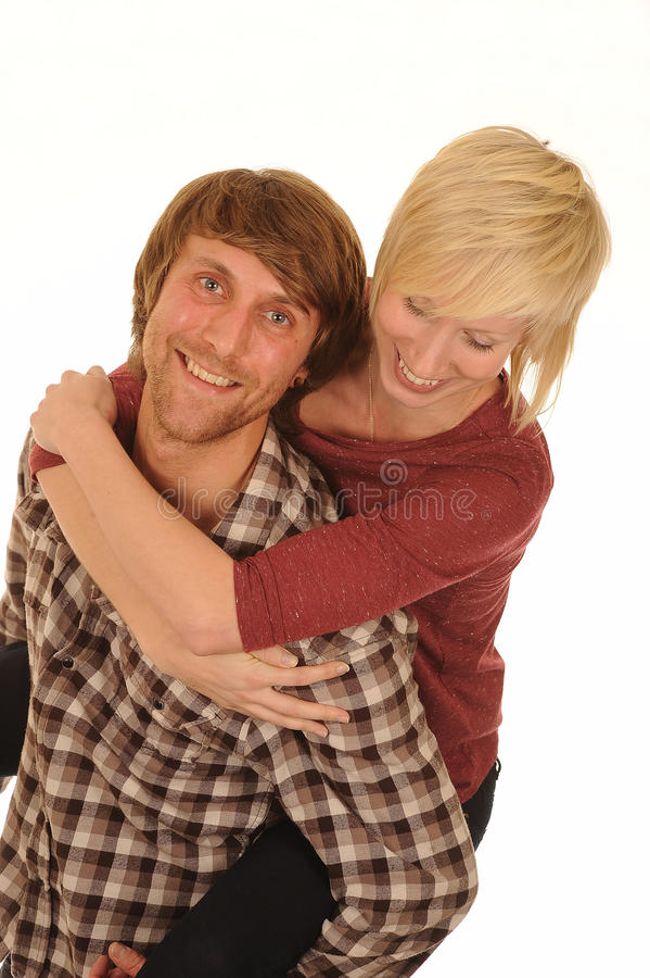 Happy young couple. Happy young man with blond haired girlfriend on shoulders, isolated on white background royalty free stock photos