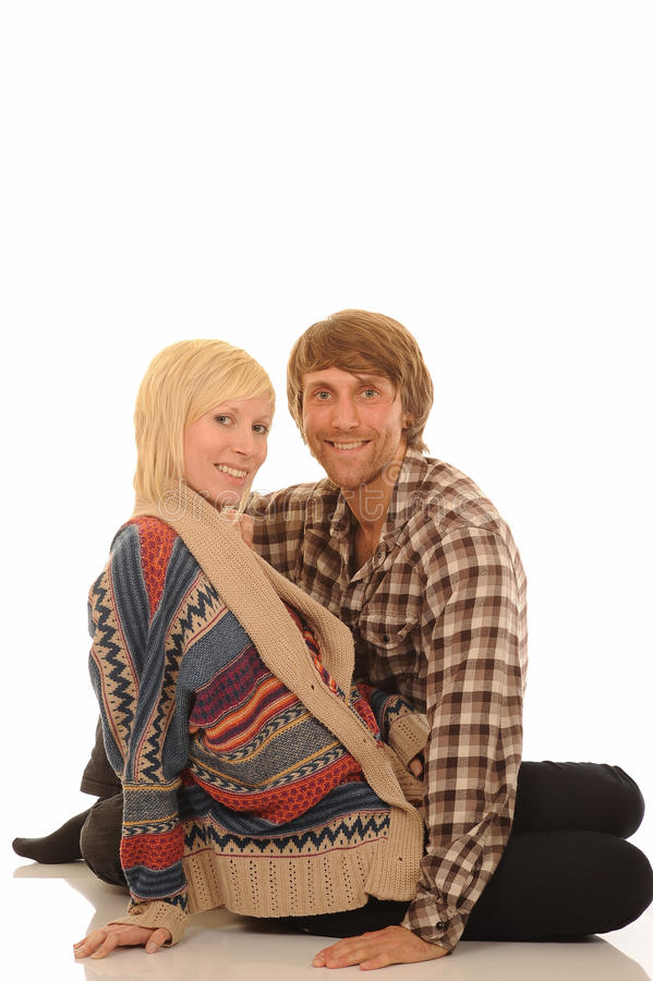 Happy young couple. In casual clothes sat on white background with copy space royalty free stock photo