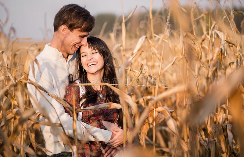 Happy young couple in autumn corn field stock photography