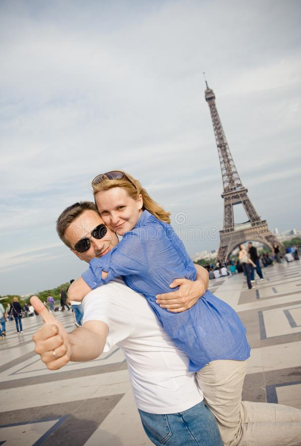Happy young couple on the background of the Eiffel Tower in Paris. Honeymoon in Europe royalty free stock photos