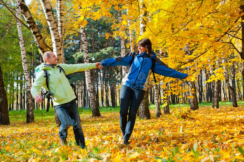 Download Happy Young Couple With Backpacks In The Park Royalty Free Stock Photography - Image: 21820647