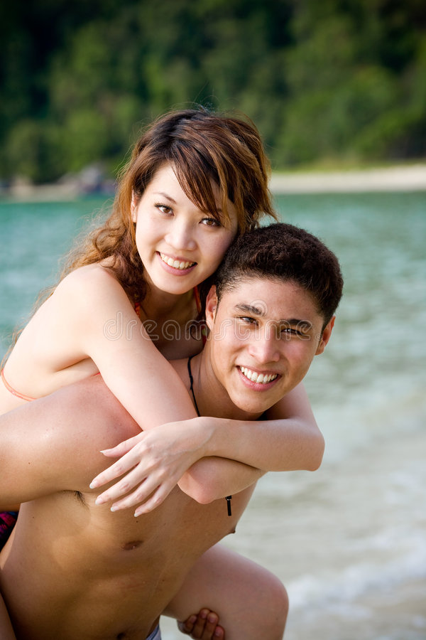 Happy young couple by the beach royalty free stock photo