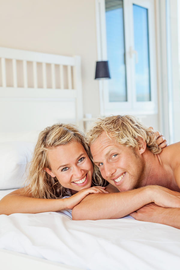 Download Happy young couple in bed stock image. Image of bonding - 28464771