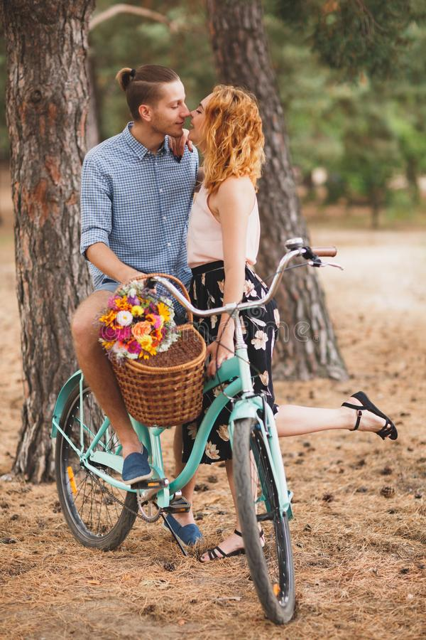 Happy young couple with bicycles in countryside royalty free stock photo