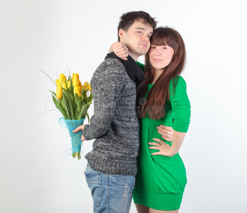 Download Happy Young Couple With Bouquet Flowers Stock Photos - Image: 23776343