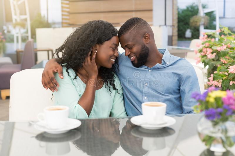 Happy young couple in cafe, having a great time together. stock images