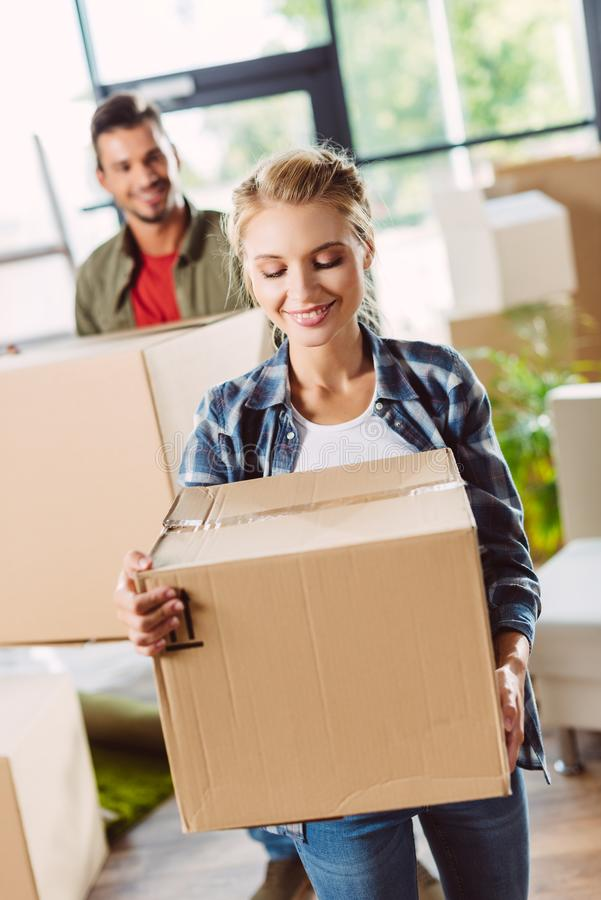 Couple with cardboard boxes in new house stock photos