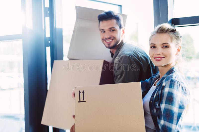 Couple with cardboard boxes in new house royalty free stock images