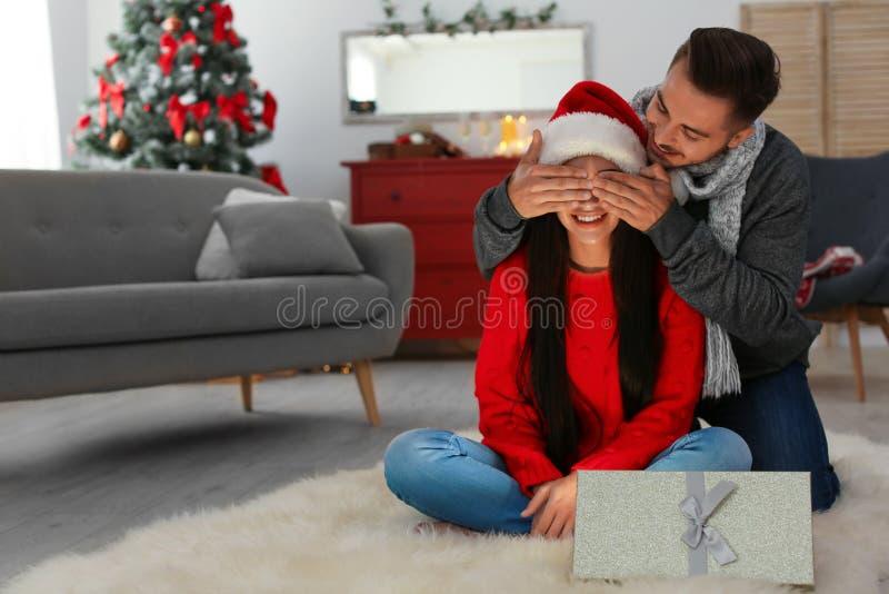 Happy young couple celebrating Christmas stock photography
