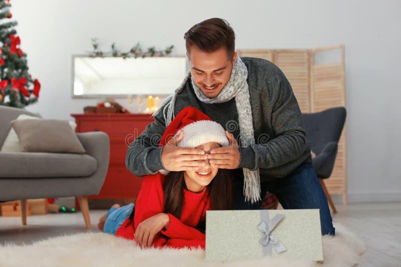 Happy young couple celebrating Christmas stock photos