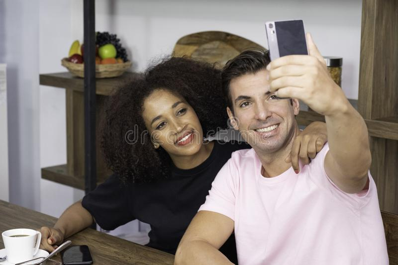 Happy young couple in a coffee house stock images