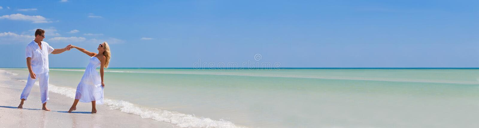 Happy Young Couple Dancing Holding Hands on Beach Panorama stock images