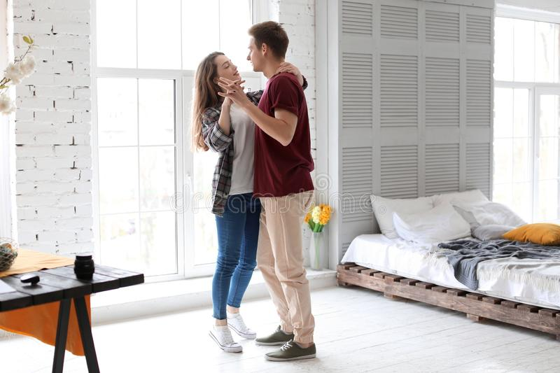 Happy young couple dancing at home stock images