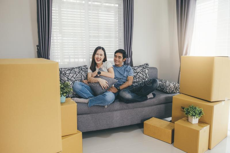 Happy young couple enjoying together moving in a new house royalty free stock image