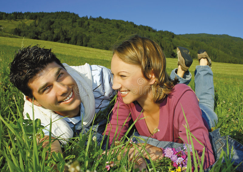Happy young couple in field stock photo