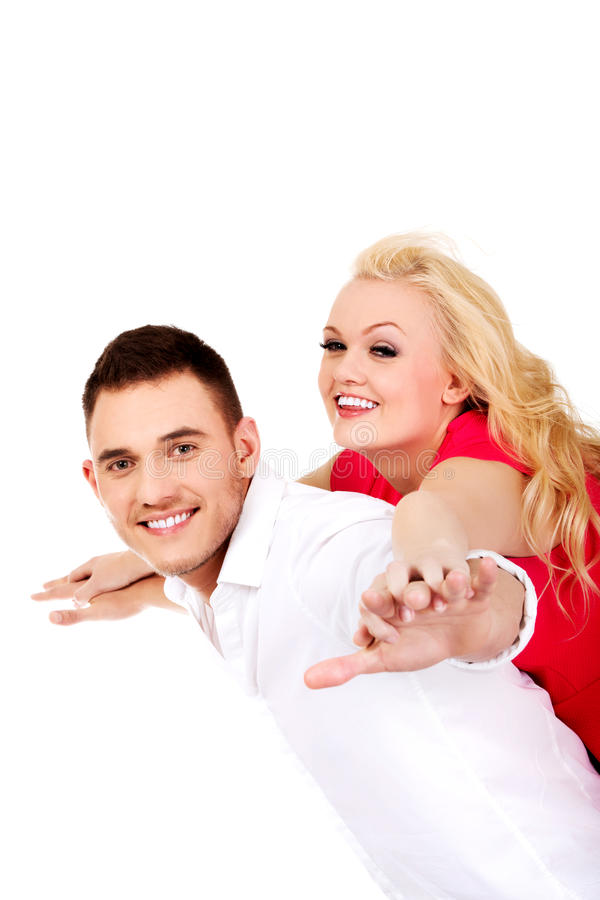 Happy young couple getting fun. royalty free stock images
