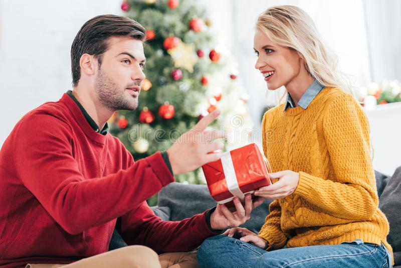 happy young couple gifting present at home stock photography