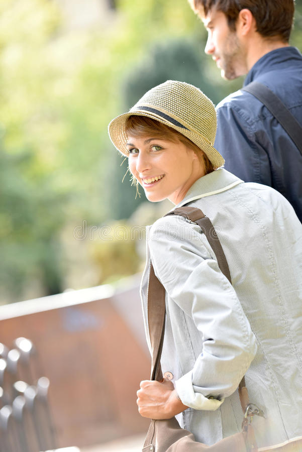 Happy young couple hanging in town royalty free stock image