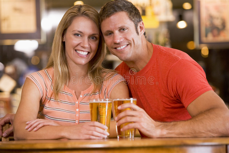 Download Happy Young Couple Having Beers At A Bar Stock Image - Image of indoors, boyfriend: 5489979