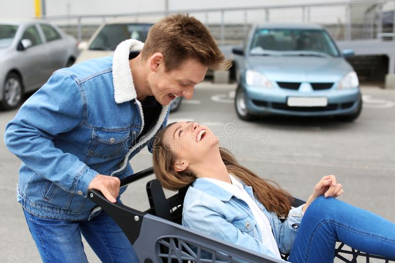 Happy young couple having fun on city street stock images
