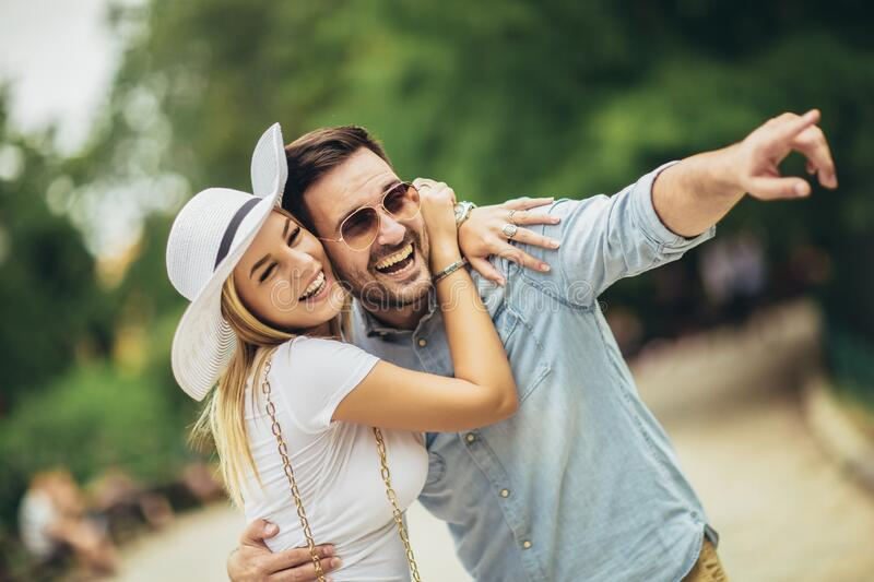 Young couple having fun outdoors and smiling royalty free stock photography
