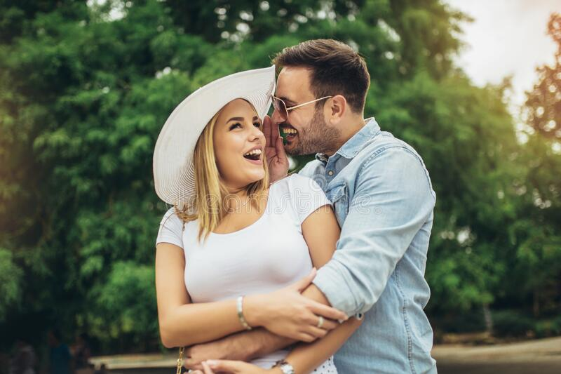 Young couple having fun outdoors and smiling royalty free stock photos