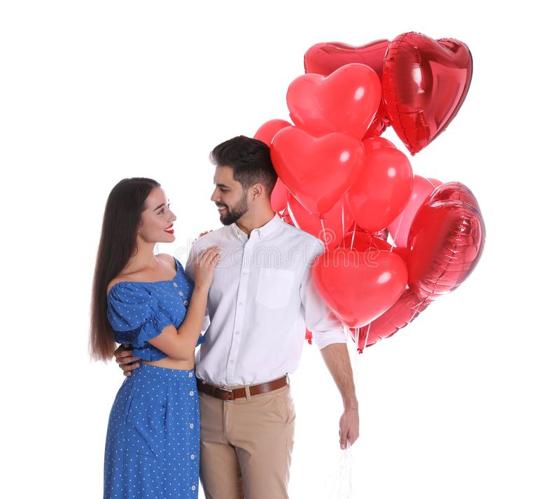 Happy young couple with heart shaped balloons isolated. Valentine`s day celebration stock photos