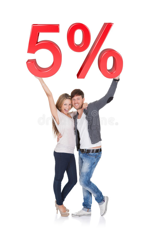 Free Happy Young Couple Holding 5 Sale Sign Stock Photography - 29378352
