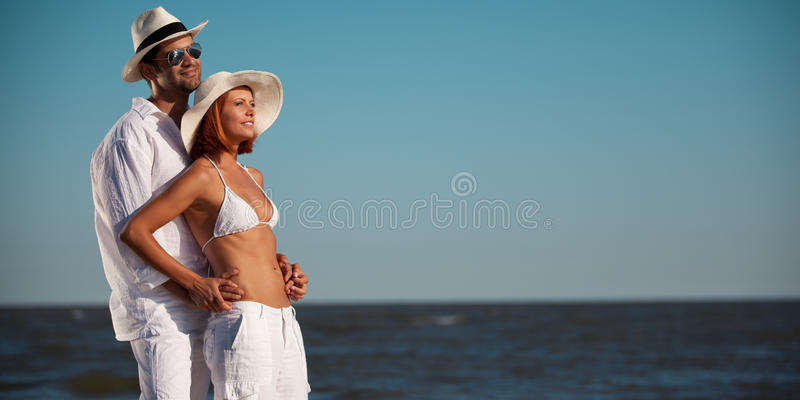 Happy Young Couple Holding Each Other Seaside Stock Photos