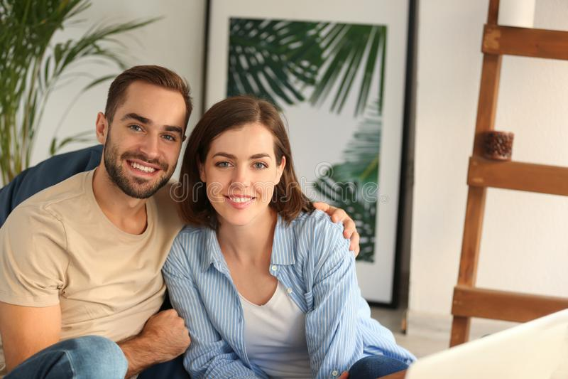 Happy young couple at home royalty free stock images