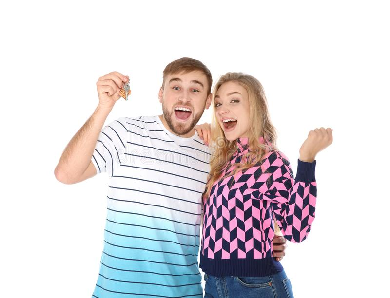 Happy young couple with house key. On white background stock photos