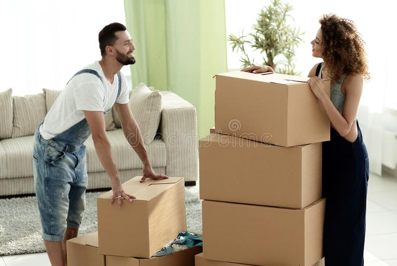 Happy and young couple looking at boxes stock image