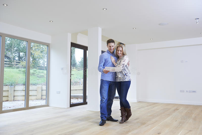 Happy Young Couple Looking At Details Of New Home. Happy Couple Looking At Details Of New Home stock images
